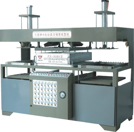Folding table vacuum forming machine