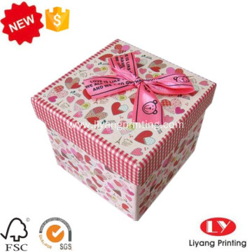 Cardboard ribbon gift packaging box with lid