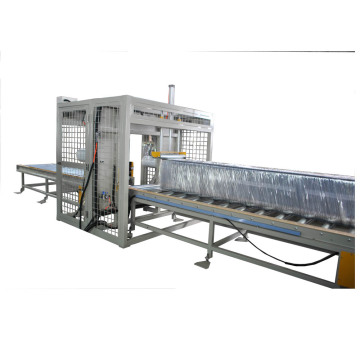 Horizontal wrapping orbital stretch film wrap machine
