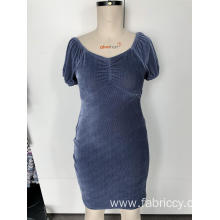 Dress with low neck and short sleeves