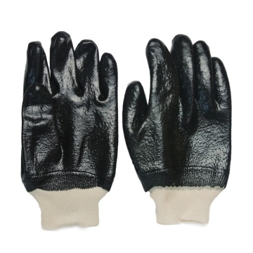 Black PVC gloves. rough finish .Knit wrist