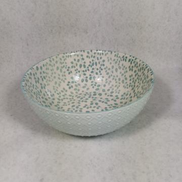 Embossed stoneware bowls and mugs