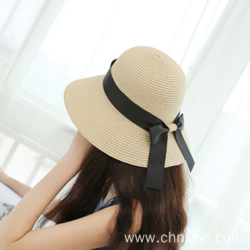 Graciously styles large bowknot straw hat
