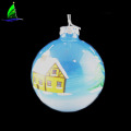 glass Christmas ball ornament with house patterns
