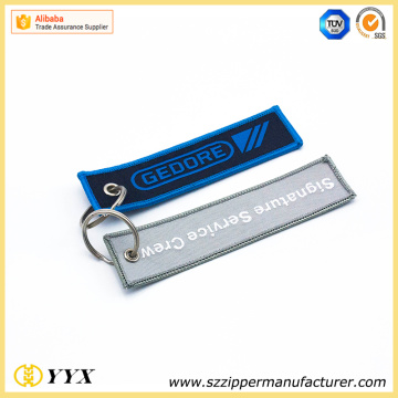 Embroided remove before flight LOGO key ring