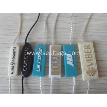 luggage labels with string and plastic bead