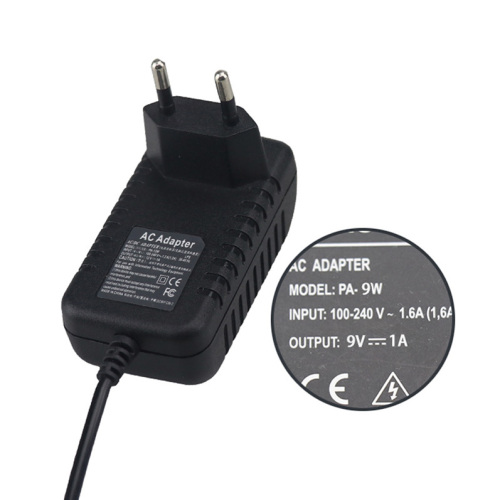 9V 1A switch adapter with EU plug adapter