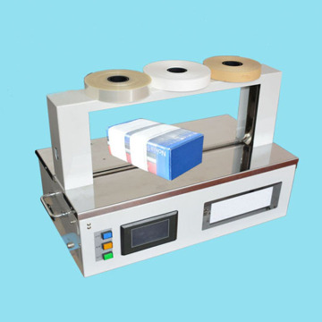 High speed banding machine for banding gifts