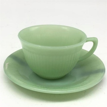 Jade green glass cup and saucer
