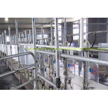 Automatic mid-set milking parlor