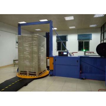 Integrated pallet wrapping and strapping machine