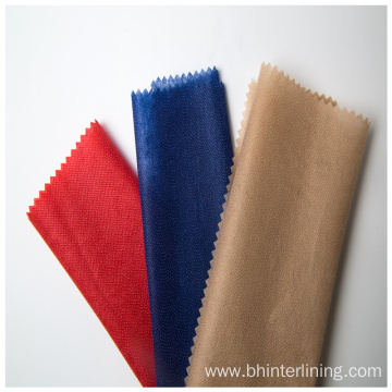 Colorful dyed nonwoven fusible lining and interlining fabric