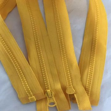 Promotional yellow plastic separating coat zippers