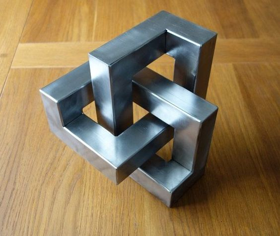 Metal trefoil sculpture