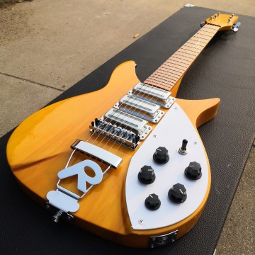 325 electric guitar has varnish on its fingerboard, light yellow paint, 527mm bridge to nut, small double-rocking