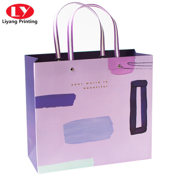 Clothing gift shopping paper bags with ribbon