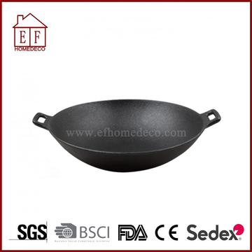 Cast iron wok with solid handle