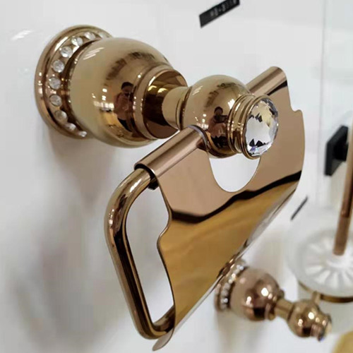 Brass toilet paper holder handy