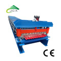 Corrugated metal roof panel machine