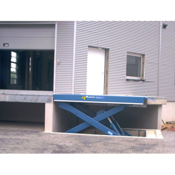 Dock lift and dock leveler
