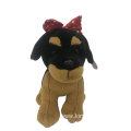Plush Dog Wearing A Red Bow