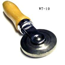 Tire repair tool corrugated rolling ball