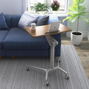 Portable height adjustable bed table