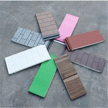 Insulated decorative steel siding panels