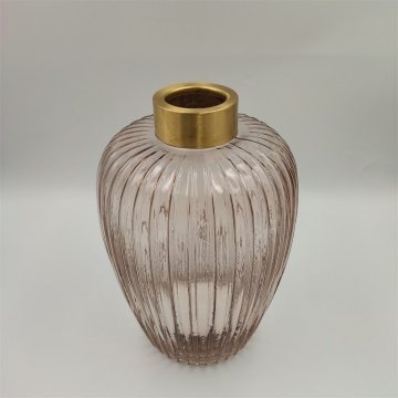 Tall glass vase with ribbed pattern