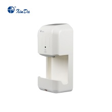 White silent hand dryer with sink