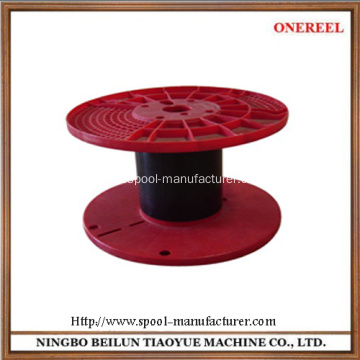 Empty plastic packing spool