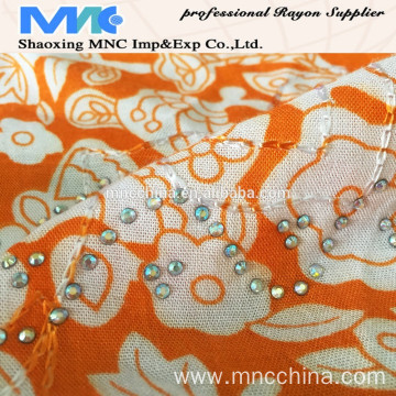 RAYON PRINT WITH EMBROIDERY AND STONE FABRIC