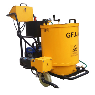Crack sealing machine for cement pavement