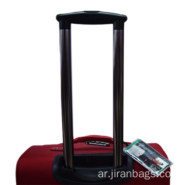 Red expandable spinner luggage for travel