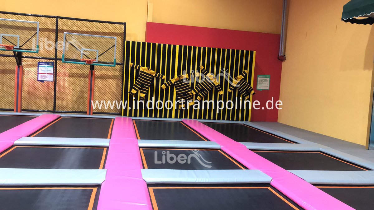 big trampoline with basketball area