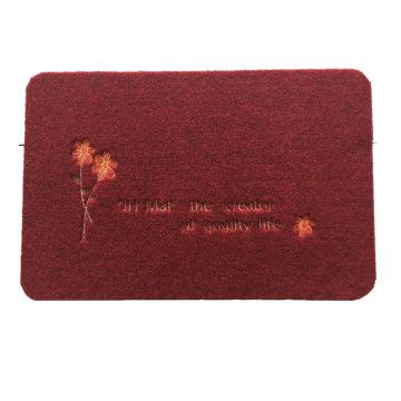 Flower embroidered dust control door mat