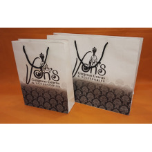 Paper merchandise bags with rope handle