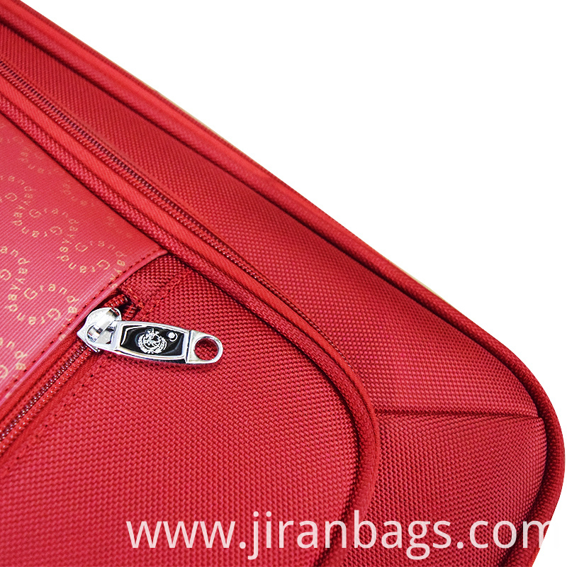 Red spinner luggage