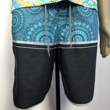 Blue and black patterned boardshorts
