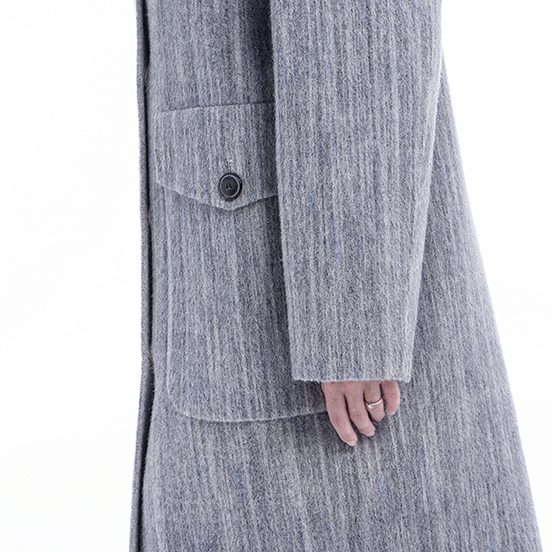 Pocket of lady's grey classic cashmere overcoat