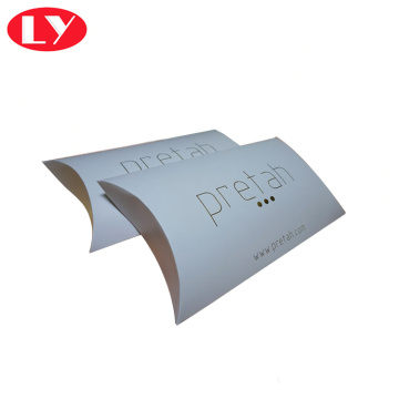 White paper pillow box with gold foil logo