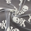 Halloween Glow in The Dark Skulls Tulle Fabric