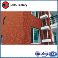 Faux exposed red brick tiles wall