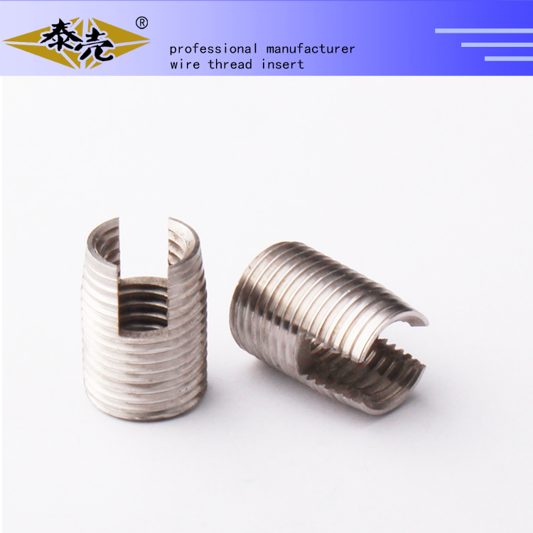 self tapping threaded inserts with cutting bores