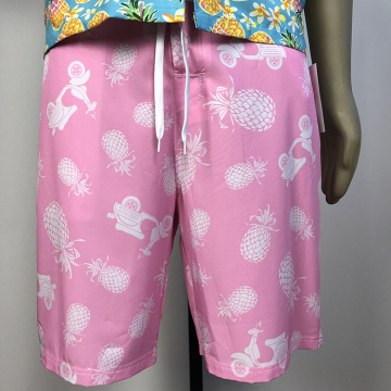 Pink pineapple-patterned beach shorts
