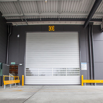Rapid roll up plastic door with loop detector