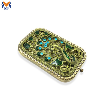 Mini square pocket mirror with peacock logo