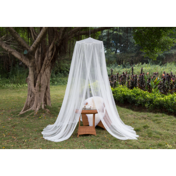 White outdoor mosquito net in the garden