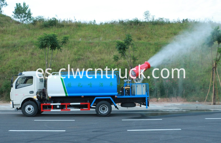 pesticide spraying truck in action