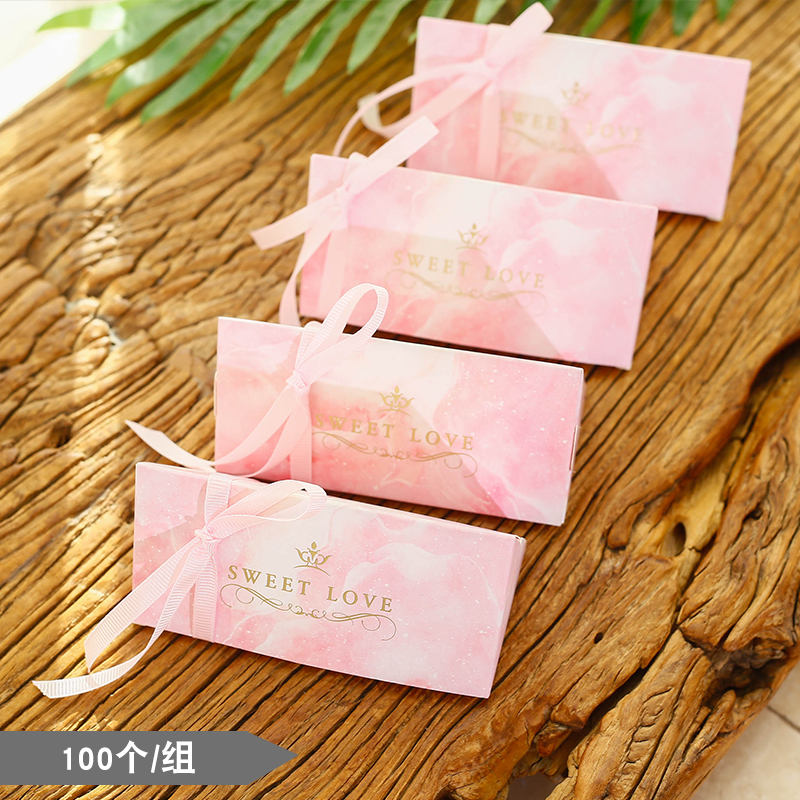 Small pink pyramid candy boxes
